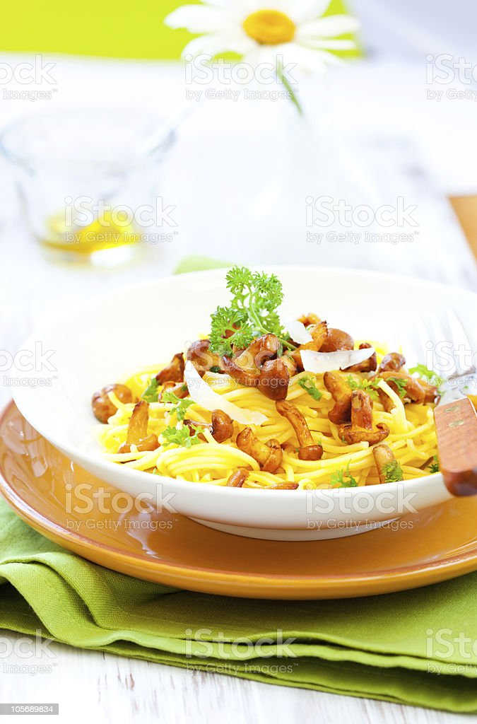 pasta with chanterelles royalty-free stock photo