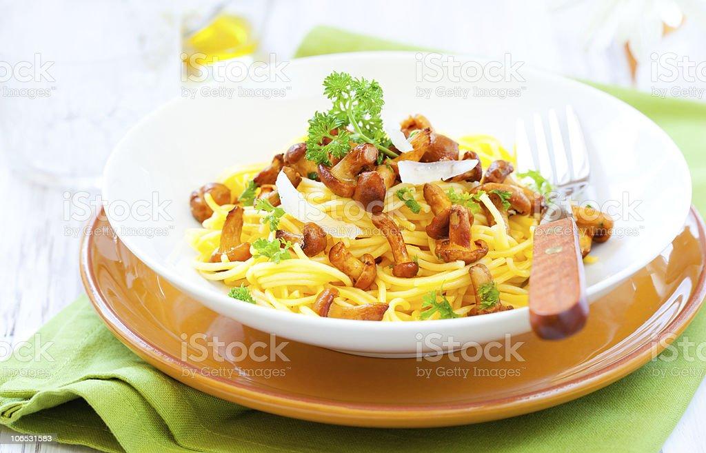 pasta with chanterelles royalty-free stock photo