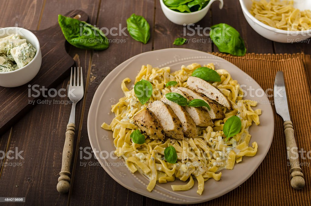 Pasta with cheese and chicken stock photo