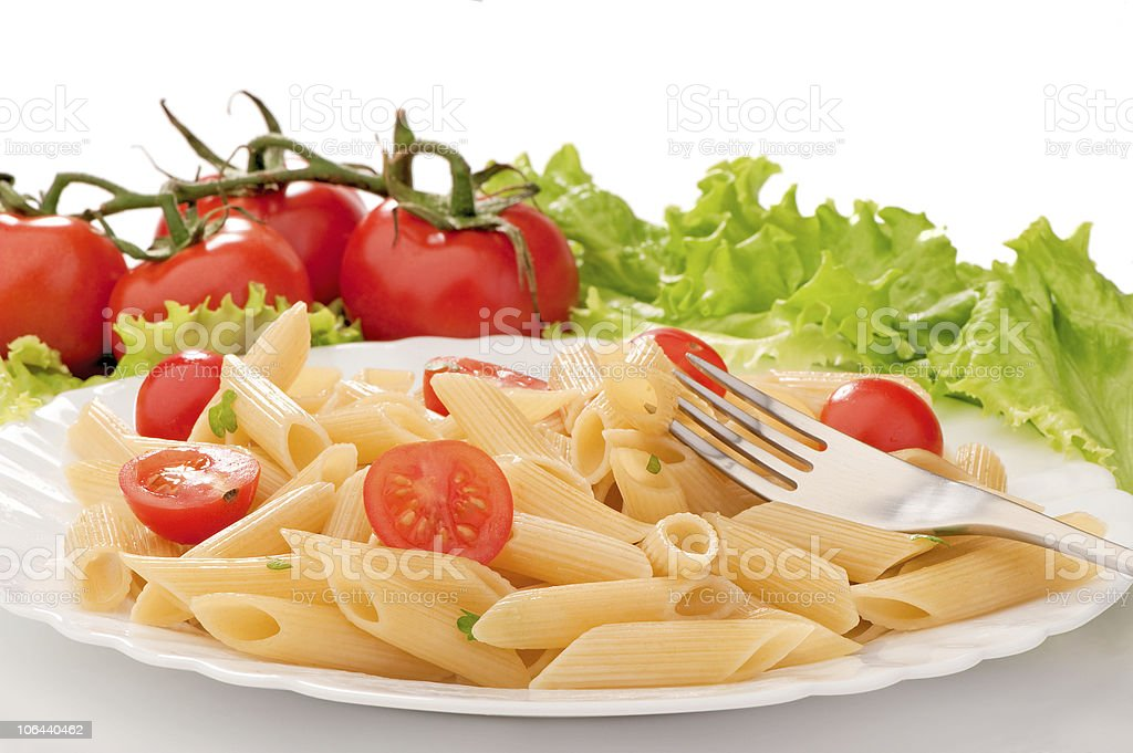 pasta with cherry tomatoes on a white plate royalty-free stock photo