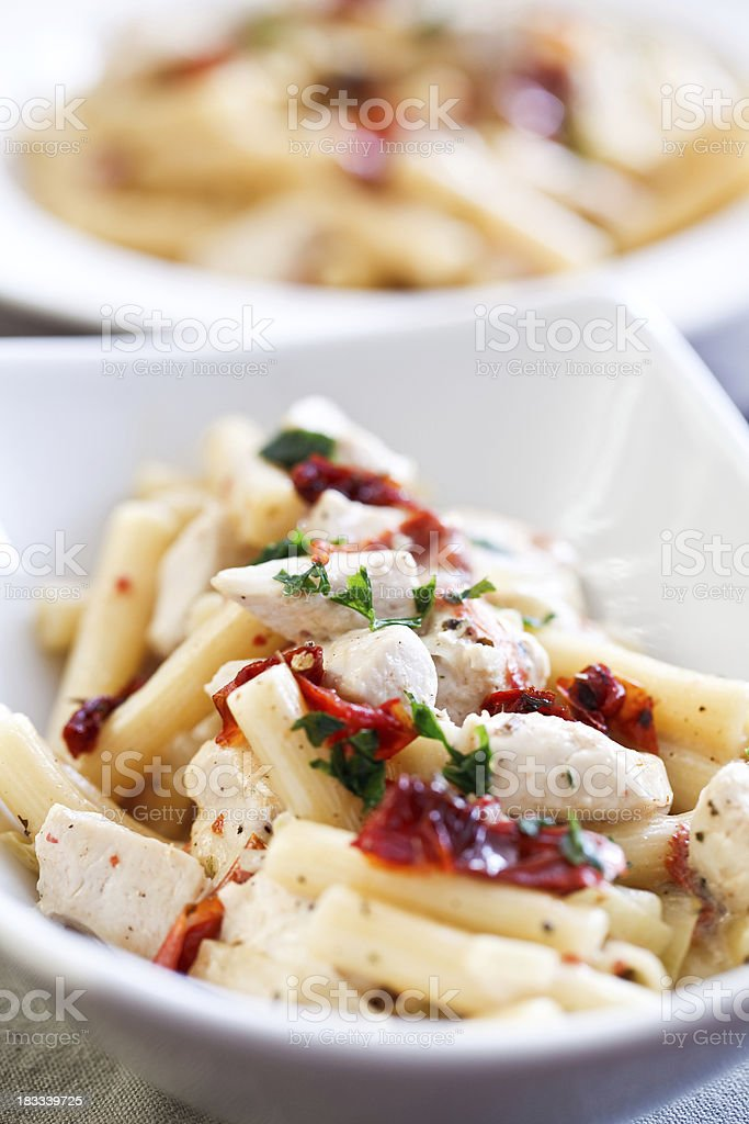 Pasta with chicken and dried tomatoes stock photo