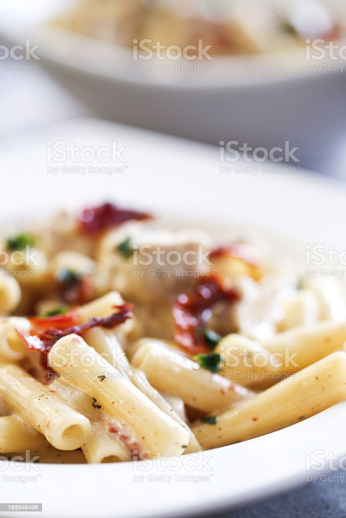 Pasta with chicken and dried tomatoes royalty-free stock photo