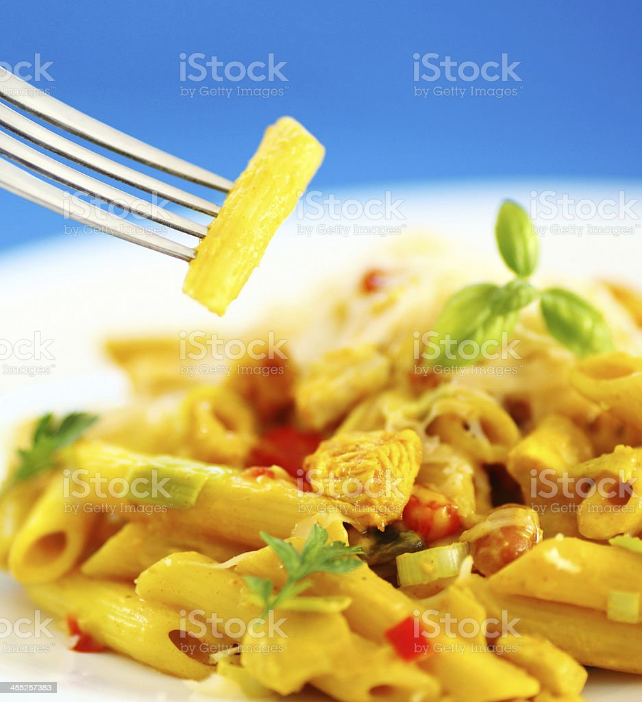 Pasta with chicken curry. stock photo