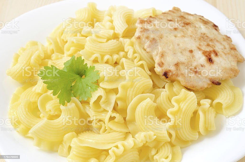Pasta with chicken cutlet royalty-free stock photo