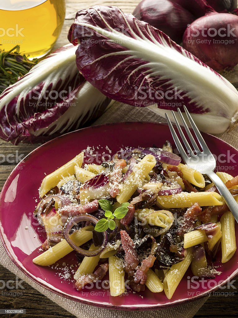 pasta with chicory bacon and parmesan cheese royalty-free stock photo