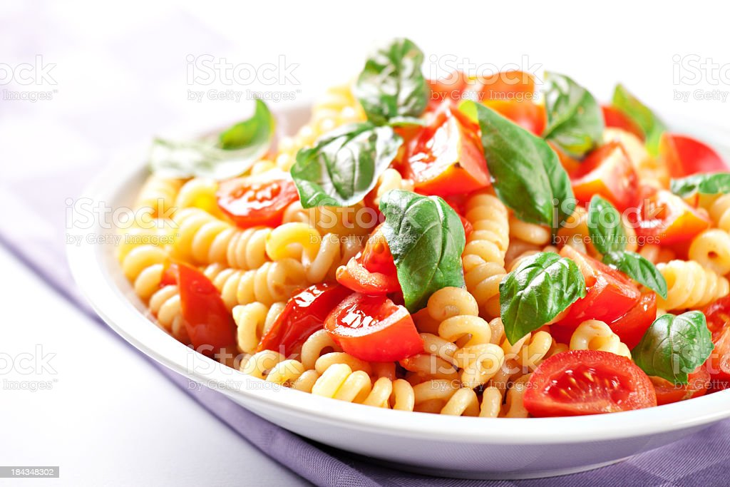 Pasta with fresh tomatoes and basil royalty-free stock photo