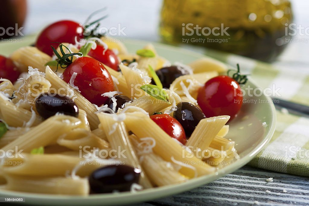 Pasta with fresh tomatoes and olives royalty-free stock photo