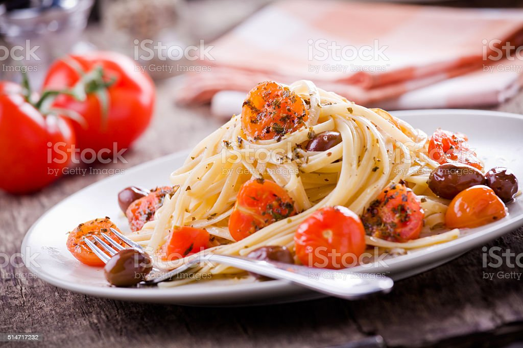 Pasta With Fresh Tomatoes And Olives stock photo