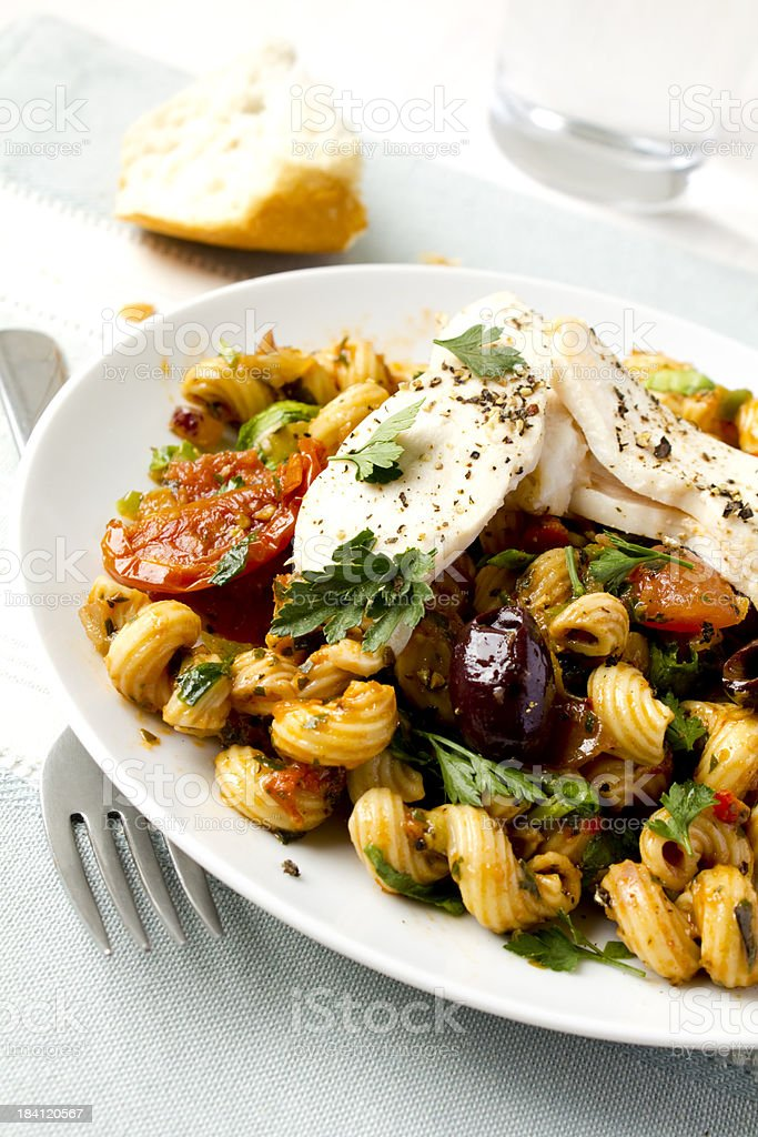 Pasta with grilled chicken stock photo