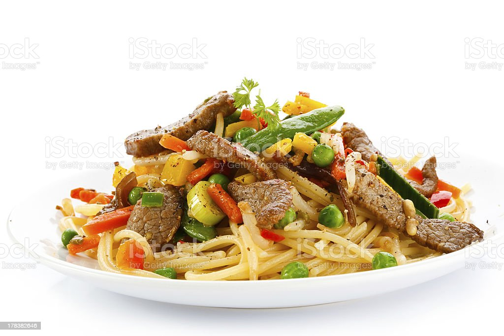 Pasta with grilled meat and vegetables royalty-free stock photo