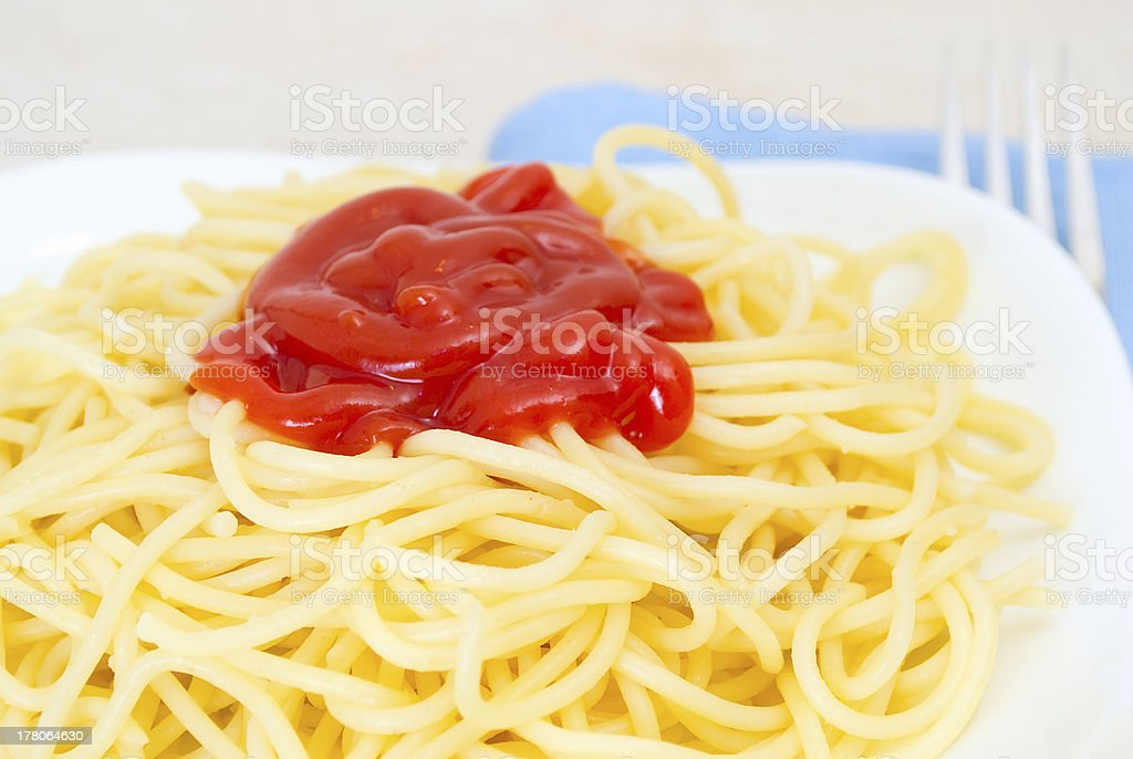 Pasta with ketchup. royalty-free stock photo