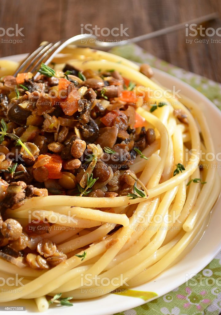 Pasta with lentil bolognese stock photo