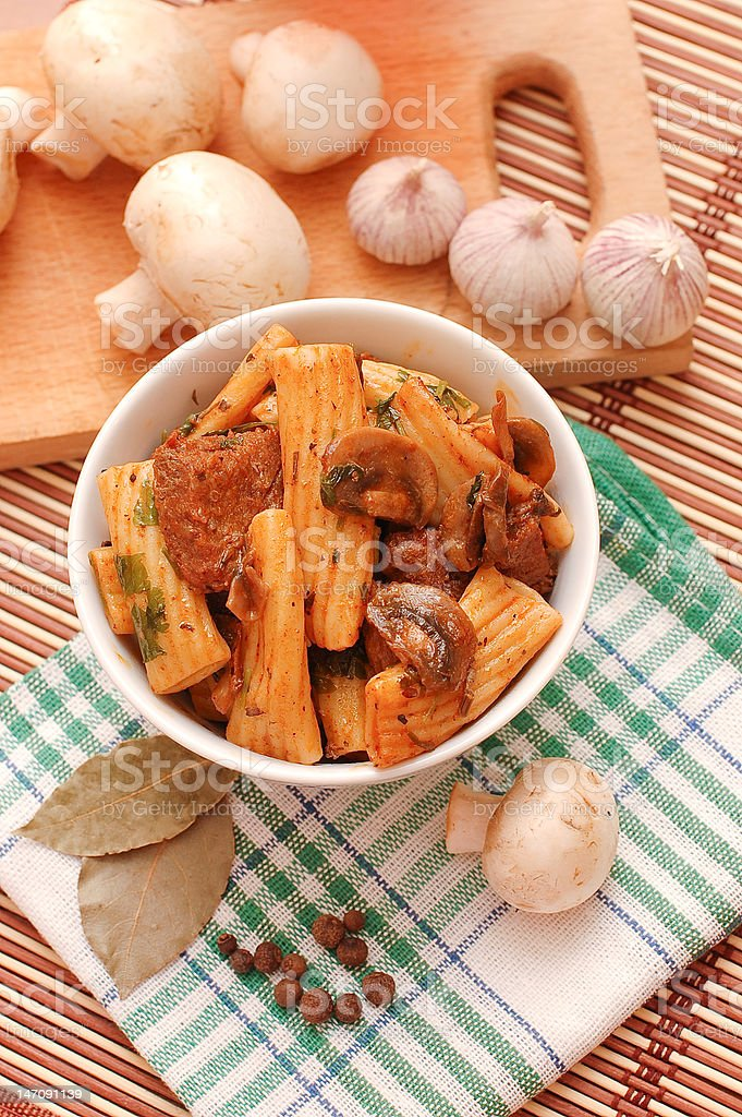 Pasta with meat and mushrooms royalty-free stock photo