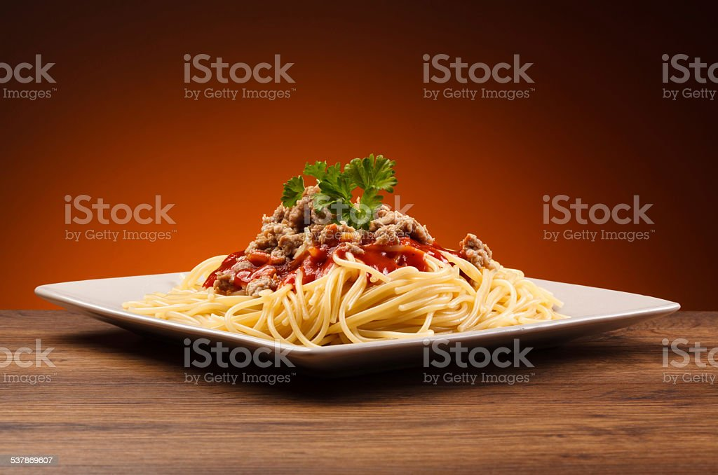 Pasta with meat, tomato sauce and parmesan stock photo