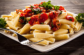 Pasta with meat, tomato sauce and parmesan