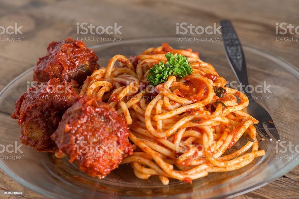 Pasta with meatballs and tomato sauce. Selective focus. stock photo
