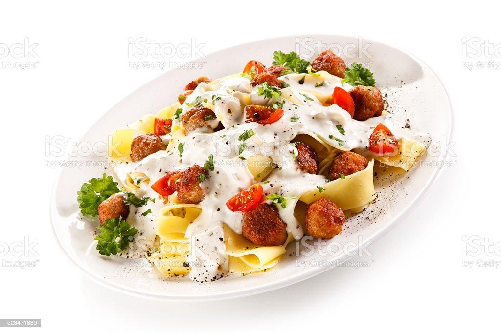 Pasta with meatballs in cream sauce stock photo