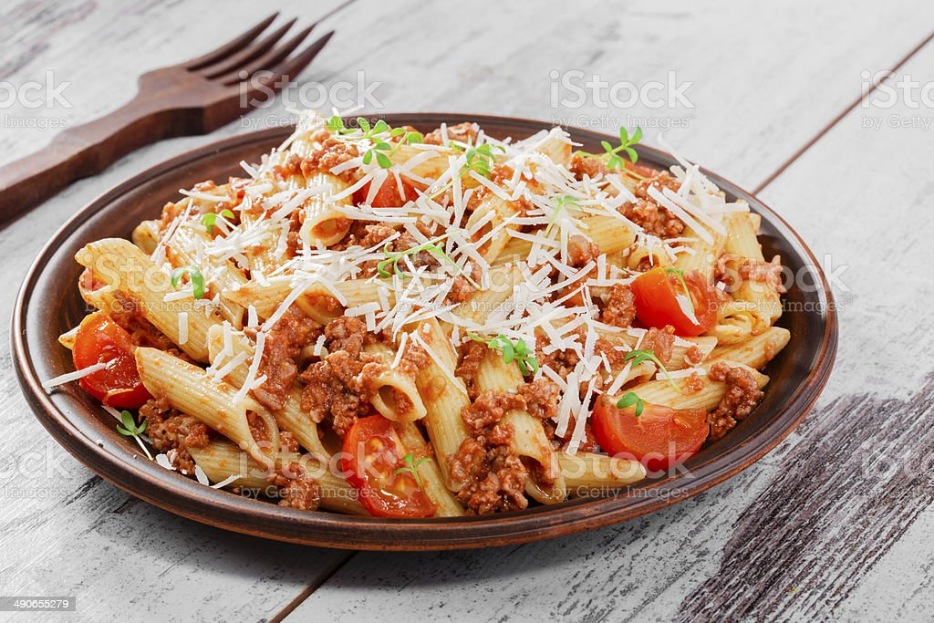 Pasta with minced meat and cheese stock photo