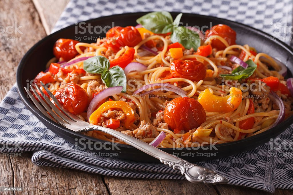 Pasta with minced meat and vegetables closeup horizontal stock photo