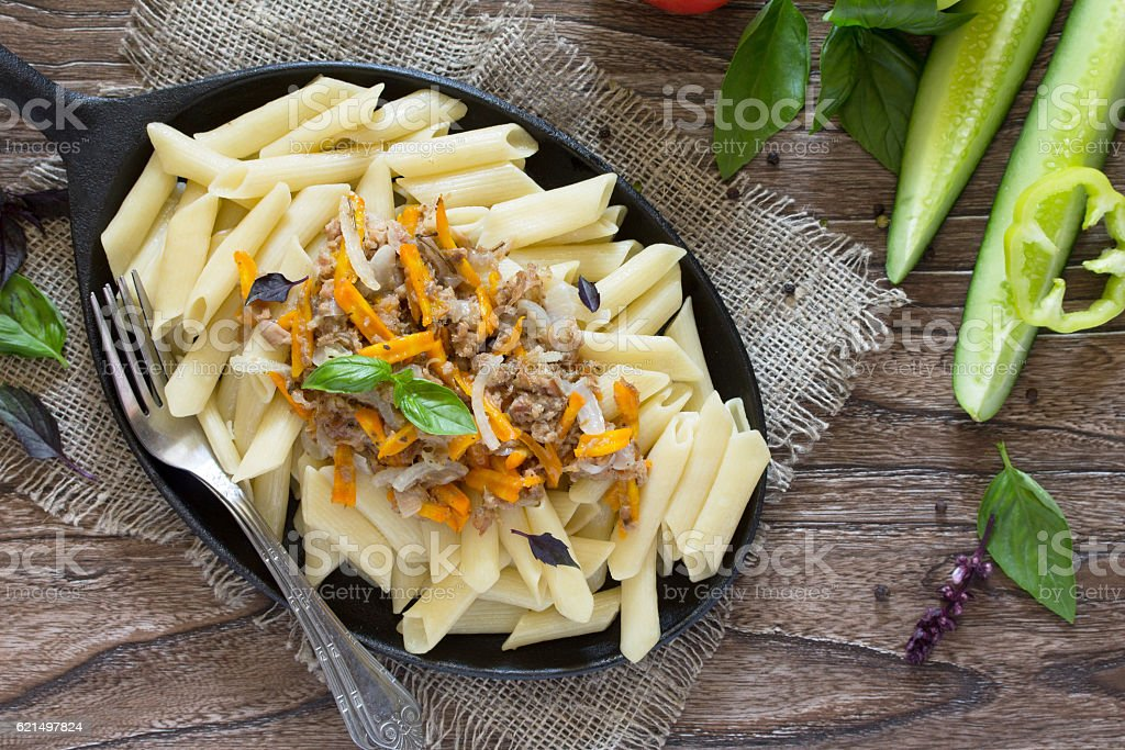 Pasta with minced meat in a frying pan stock photo