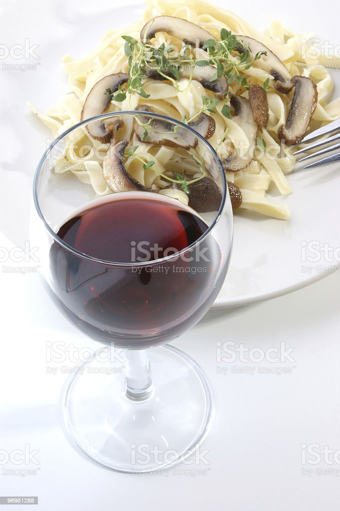 Pasta with mushroom and red wine stock photo