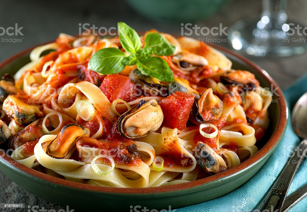 Pasta with Mussels in Marinara Sauce stock photo
