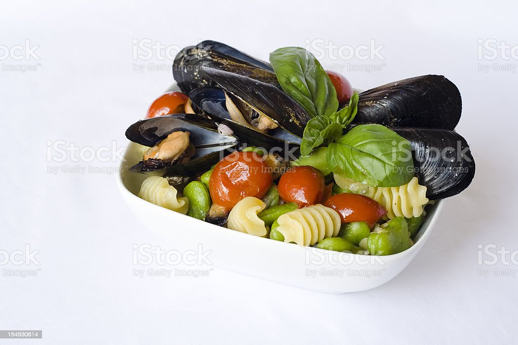 Pasta with Mussels, Tomatoes and Fava Beans stock photo