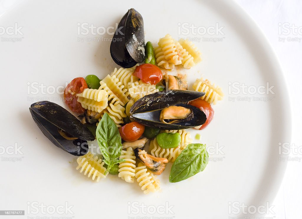Pasta with Mussels, Tomatoes and Fava Beans royalty-free stock photo