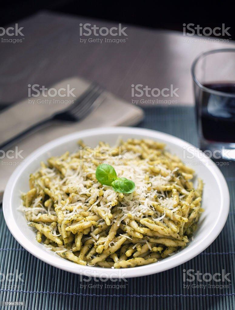 Pasta with pesto sauce stock photo