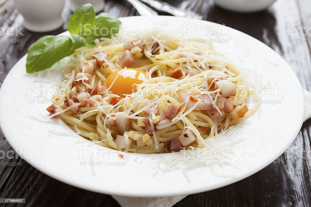 pasta with pieces of bacon and parmesan stock photo