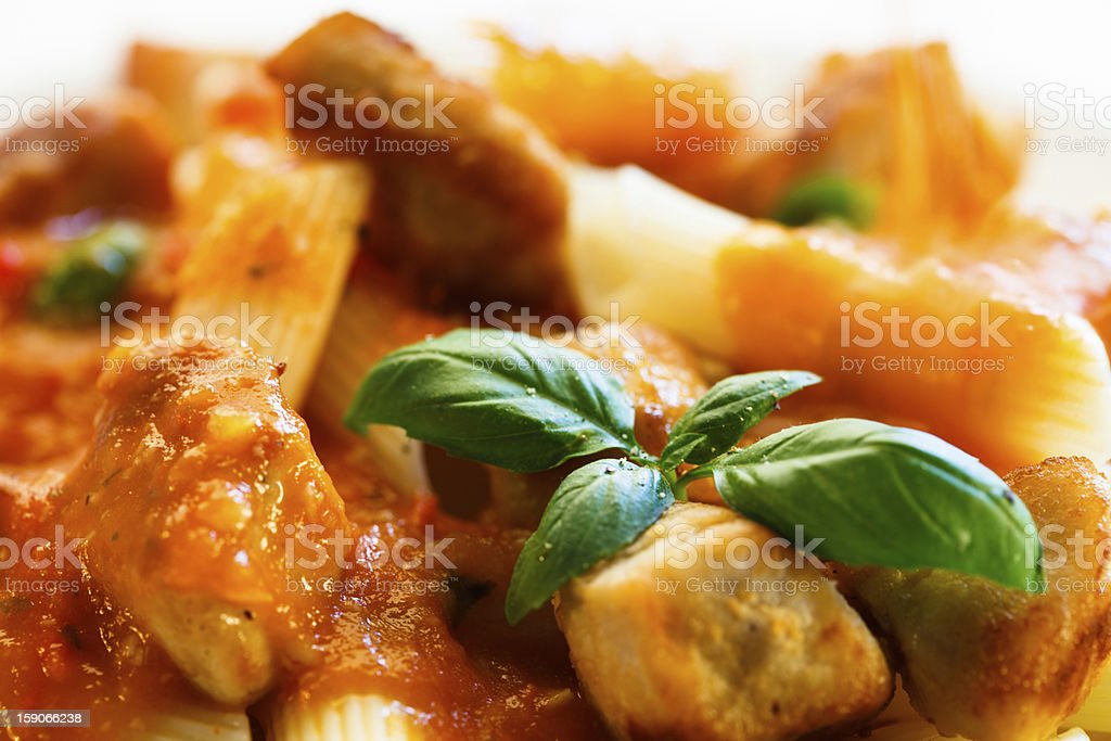 Pasta with roasted meat and tomato sauce stock photo