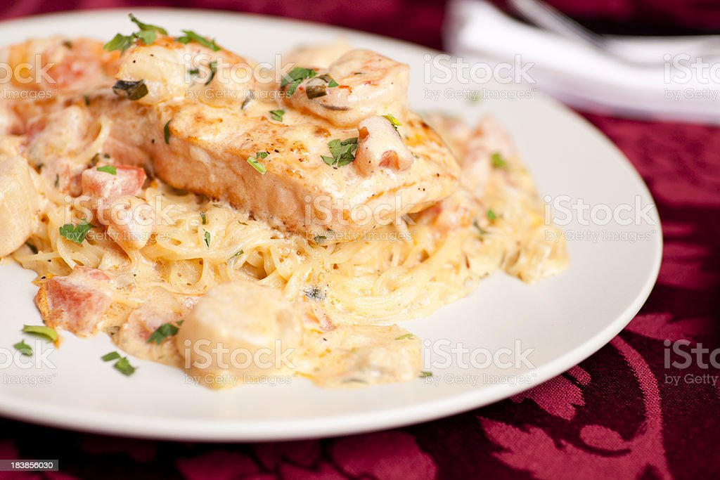 Pasta with salmon scallops and shrimp royalty-free stock photo