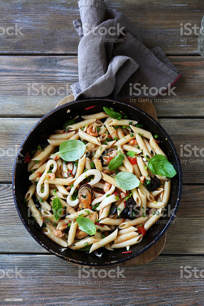 pasta with seafood and sauce stock photo