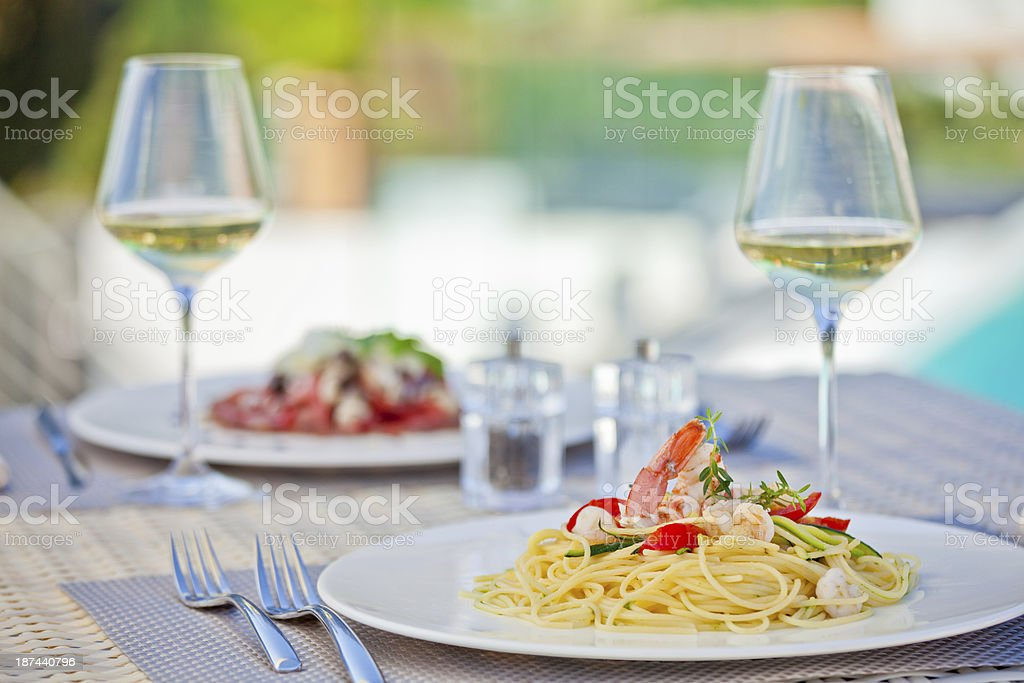 Hotel terrace restaurant at summer, meal for two