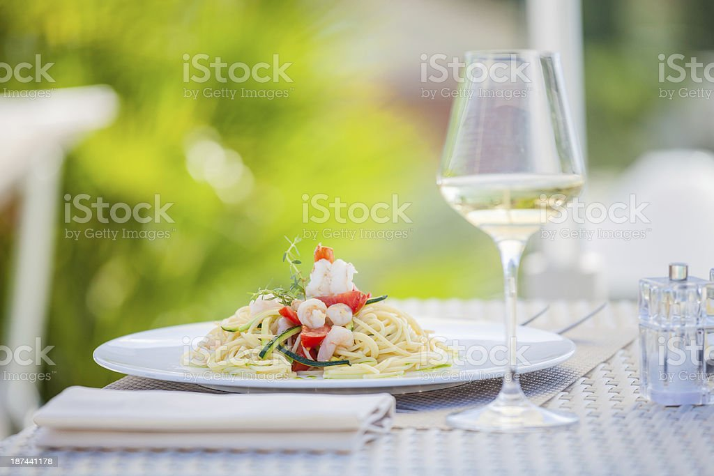 Pasta with Seafood and White Wine in Restaurant at Summer royalty-free stock photo