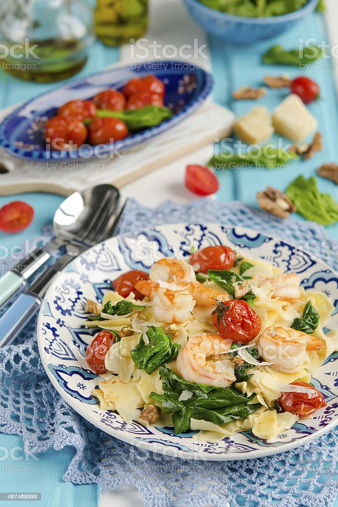 Pasta with shrimp, spinach and cherry tomatoes royalty-free stock photo