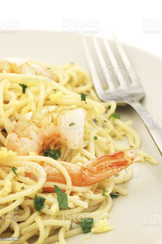 Pasta with shrimps and parsley on plate - isolated royalty-free stock photo