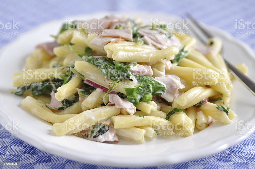 Pasta with spinach and bacon royalty-free stock photo
