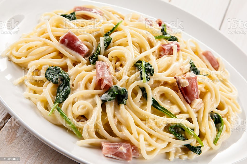 Pasta with spinach and bacon stock photo