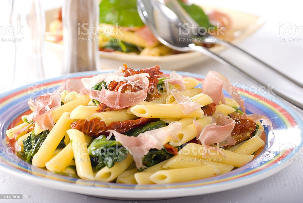pasta with spinach parma ham and tomatoes royalty-free stock photo
