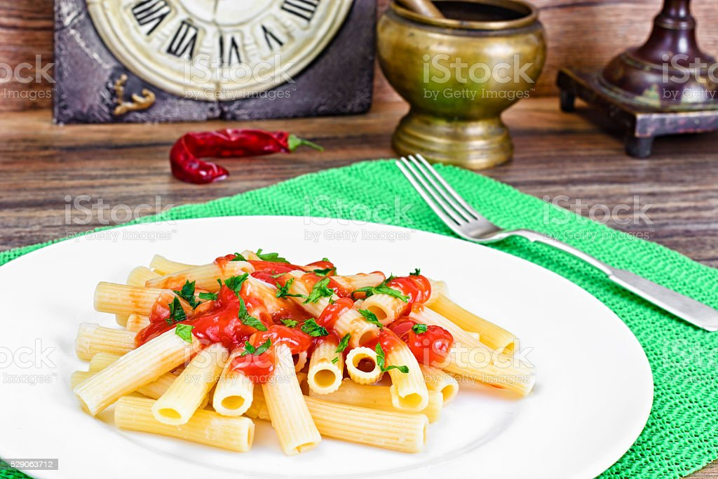 Pasta with Tomato Ketchup Sauce, Green Onions and Cheese stock photo
