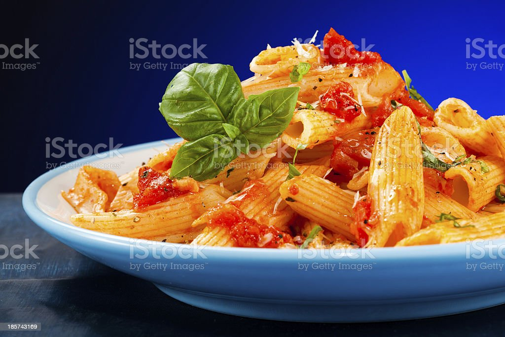 Pasta with tomato sauce and parmesan royalty-free stock photo