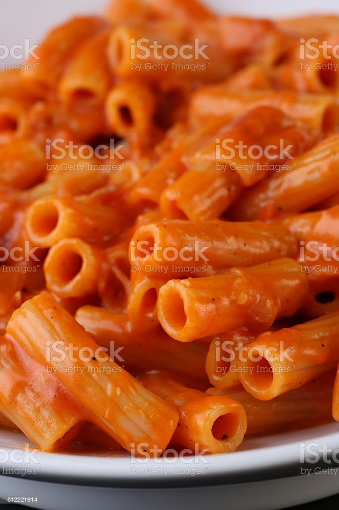 Pasta with tomato sauce on whit plate, close up stock photo