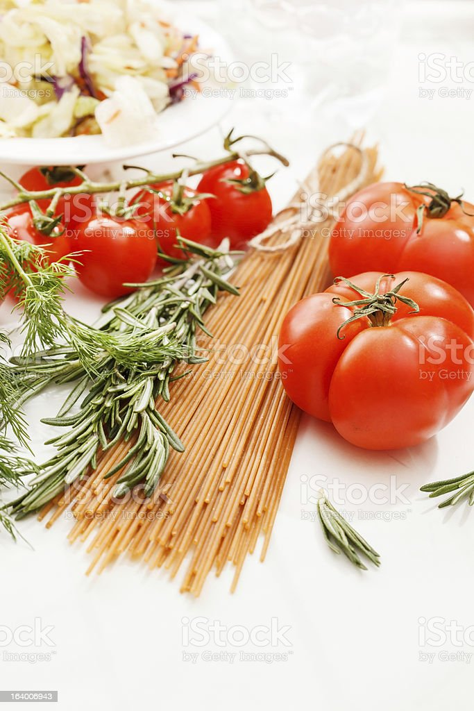 Pasta with tomatoes and herbs royalty-free stock photo