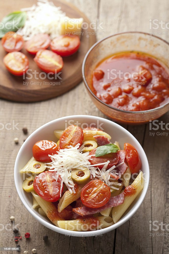 pasta with tomatoes and salami royalty-free stock photo
