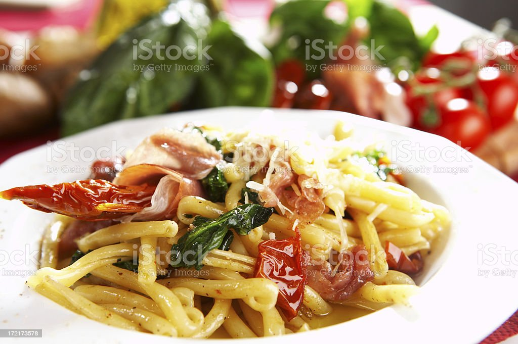 pasta with tomatoes, spinach and parma ham royalty-free stock photo
