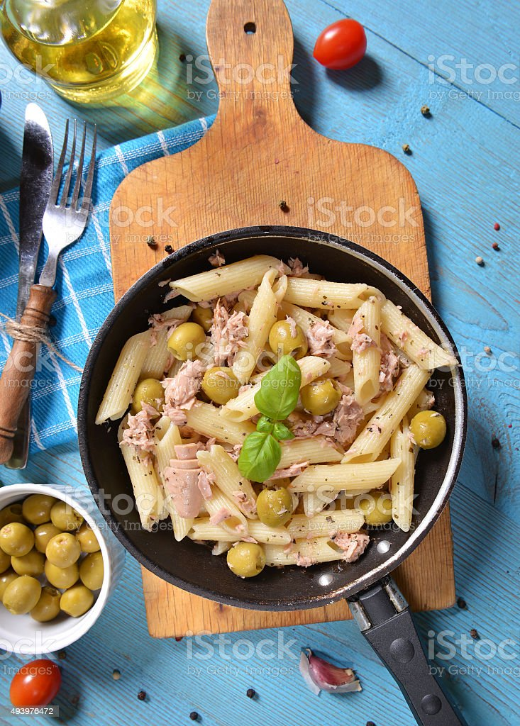 Pasta with tuna and green olives stock photo