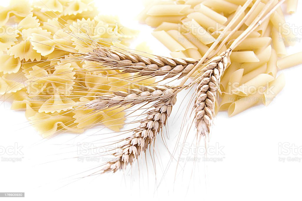 Pasta with wheat ears royalty-free stock photo