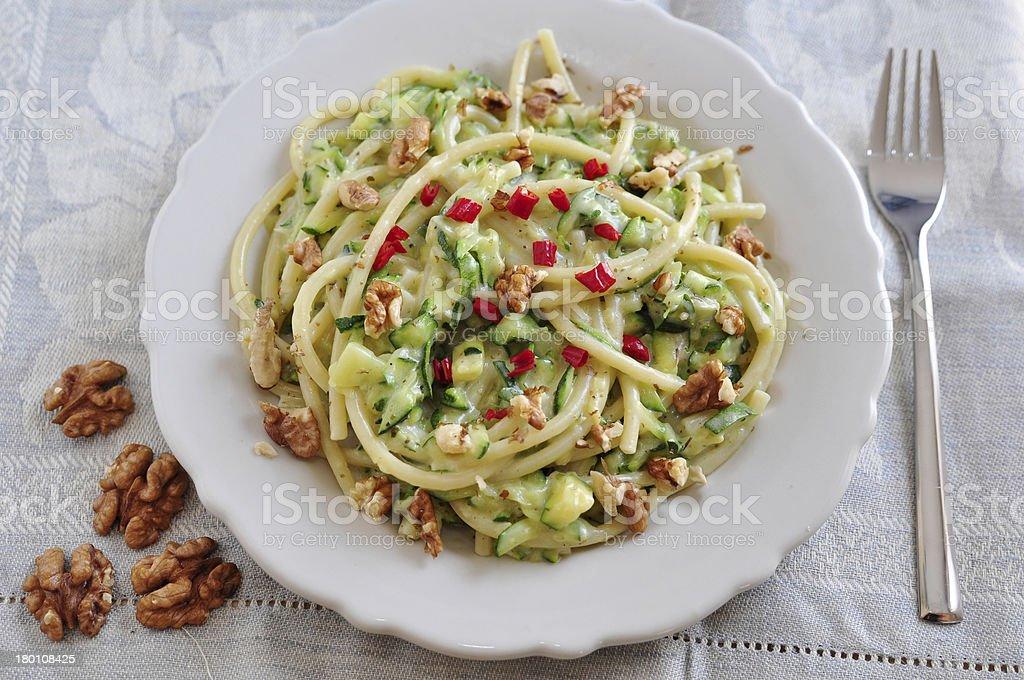 Pasta with zucchini, waltnut and chili pepper royalty-free stock photo