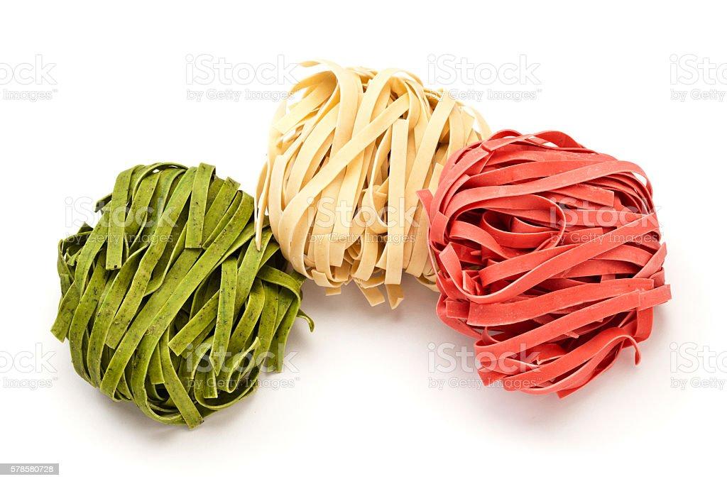 Pasta-Tagliatelle with the italian flag colors stock photo
